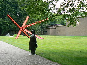 Mark di Suvero - Entrance to the Kröller-Müller Museum and sculpture park in Otterlo/The Netherlands. In the background the red K-piece by Mark di Suvero