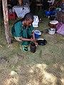 Ethiopian Lady grinding coffee seeds (Jebena Buna).jpg