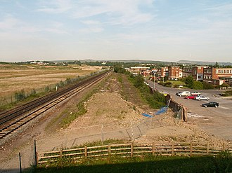 Royal Ordnance - View of the cleared ROF Chorley site. The explosive filling site was to the right of the railway; the area between the railway and the hedge was the site of ROF Chorley Halt; and to the right of the hedge is the former Headquarters building for ROF Chorley.