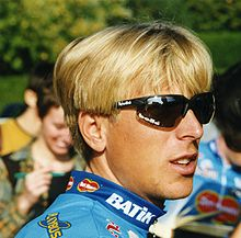 A blonde haired man wearing sunglasses.