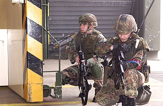 Air force infantry and special forces - An airman of the German Air Force Regiment (right) together with an American Security Forces Specialist during an anti-terrorist exercise at Büchel Air Base, Germany in 2007.