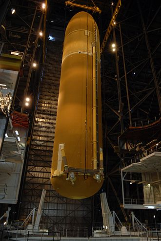 Space Shuttle external tank - External tank No. 124 is lowered into high bay 1 of the Vehicle Assembly Building where it will be mated with the solid rocket boosters for mission STS-117.
