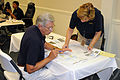 FEMA - 42152 - Community Relations Workers Plan Outreach at Disaster Recovery C.jpg