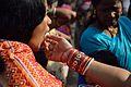 Feeding Rasgulla - Chhath Festival - Strand Road - Kolkata 2013-11-09 4281.JPG
