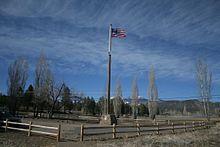 Flagpole in a field