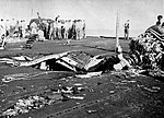 Flight deck damage aboard USS Belleau Wood (CVL-24) after she was hit by a Kamikaze, 30 October 1944.jpg