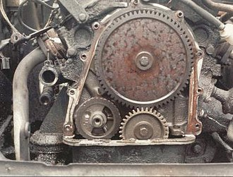 Gear train - Valve timing gears on a Ford Taunus V4 engine — the small gear is on the crankshaft, the larger gear is on the camshaft. The crankshaft gear has 34 teeth, the camshaft gear has 68 teeth and runs at half the crankshaft RPM. (The small gear in the lower left is on the balance shaft.)