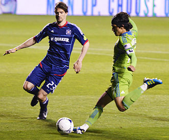 Fredy Montero - Montero (right) crosses the ball in front of Chicago Fire defender Arne Friedrich