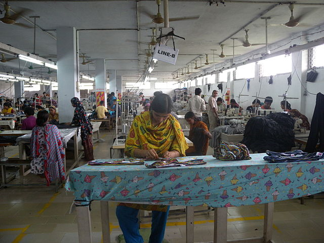 Women working under oppressive conditions in a Bangladesh garment factory.