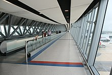Enclosed corridor with moving walkway
