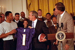 2000 Baltimore Ravens season - Rod Woodson presents a jersey to President George W. Bush during the Ravens' White House visit, June 8, 2001