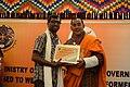 George Thengummoottil receiving award from Jai Bir Rai.jpg