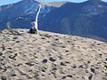 Girl Doing a Cartwheel on Top of a Dune (12660725705).jpg