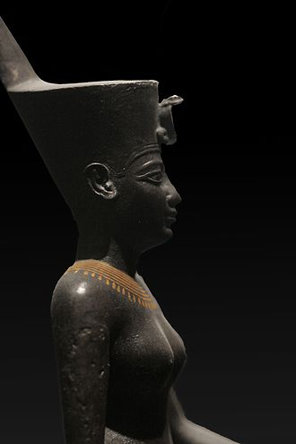 Goddess - A statue of the Egyptian war goddess Neith wearing the Deshret crown of northern (lower) Egypt, which bears the cobra of Wadjet.