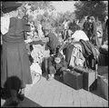 Granada Relocation Center, Amache, Colorado. Children guard the family possessions while awaiting t . . . - NARA - 539945.tif