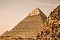 Great Pyramid of Giza (Khufu's pyramid), Pyramid of Khafre, Pyramid of Menkaure (right to left). Giza, Cairo, Egypt, North Africa.jpg