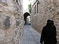 Hama, Stone alleys of the old city of Hama, Women in niqab, Syria.jpg