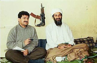 Osama bin Laden - Pakistani journalist Hamid Mir interviewing Osama bin Laden in Kabul in 1997. The AKS-74U in the background is a symbol of the mujadin's victory over the Soviets, since these weapons were captured from Spetsnaz forces.