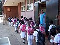 Happy little kids going for their toilet break in an orderly fashion to use clean Beautiful School Toilets we provide to South African Schools without our Government support. (6662209327).jpg