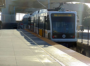 Harbor Freeway station - Westbound Metro Green Line train to Redondo Beach Station departing Harbor Freeway Station.