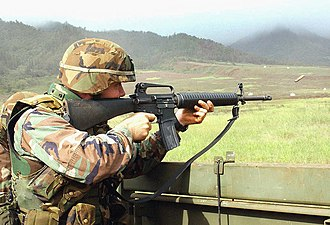 Schofield Barracks - A U.S. Army soldier fires an M16A2 rifle at Schofield Barracks in December 2003.