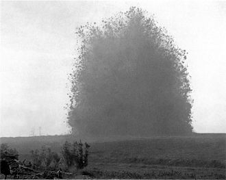 Tunnel warfare - Explosion of the mine beneath Hawthorn Ridge Redoubt on the Western Front during World War I (July 1, 1916). Photo by Ernest Brooks