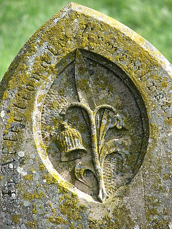 English: Headstone detail A number of 19th cen...