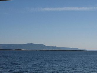 Heron Island (New Brunswick) - Heron Island as seen from New Brunswick with Quebec's Mont Saint-Joseph in background.
