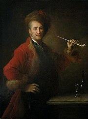 Homme en costume polonais, une pipe à la main
