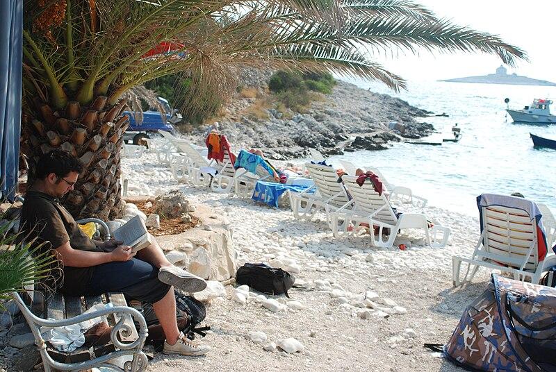 File:Hvar beach reading again!.jpg