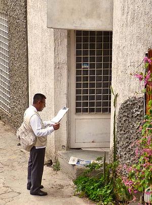 National Institute of Statistics and Geography (Mexico) - An INEGI employee going door-to-door gathering Census information in Oaxaca de Juárez.