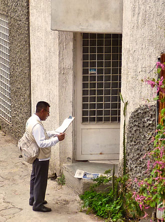National Institute of Statistics and Geography - An INEGI employee going door-to-door gathering Census information in Oaxaca de Juárez.