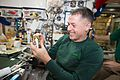 ISS-50 Shane Kimbrough with cookies at Christmas Eve.jpg