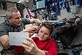 ISS-59 David Saint-Jacques trims Anne McClain's hair inside the Harmony module.jpg