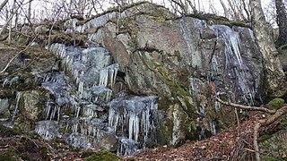 Icicles adorn a rocky outcrop.jpg