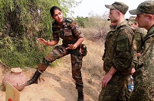 Women in the military by country - A female officer in the Indian Army briefing Russian soldiers during a joint exercise in 2015.
