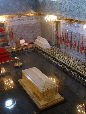 Mohammed V of Morocco - Mohammed V's tomb inside his mausoleum at Rabat, with Hassan II's tomb in the background