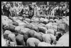 Iranian men bow in prayer during demonstration for khomeini.tif