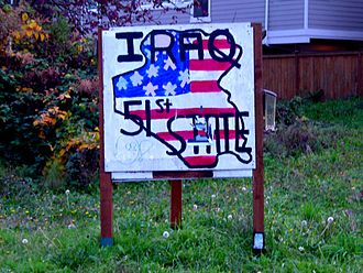 51st state - A resident of Seattle, Washington, through a homemade sign, facetiously declares that the Republic of Iraq is the 51st U.S. state.