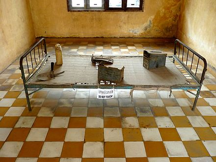 Iron bed in torture room at Tuol Sleng Genocide Museum Iron bed in Tuol Sleng prison.JPG