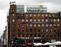 Jyllands-Posten advertisement atop a building
