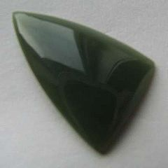 A freeform triangular cabochon of olive-green Wyoming nephrite jade.