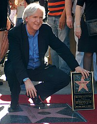 A photograph of Cameron receiving a star on the Hollywood Walk of Fame in 2009