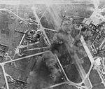 Japanese aircraft and installations burning at Tan Son Nhut airfield, near Saigon, during strikes by USS WASP aircraft, 12 January 1945.jpg