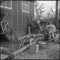 Jerome Relocation Center, Denson, Arkansas. Mrs. T. Arima busily prepares her doorstep garden in Bl . . . - NARA - 538835.tif