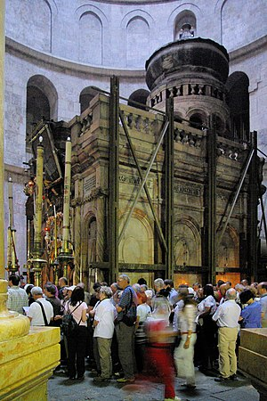 Monza ampullae - Modern pilgrims at the aedicule over the tomb of Christ in the Church of the Holy Sepulchre.