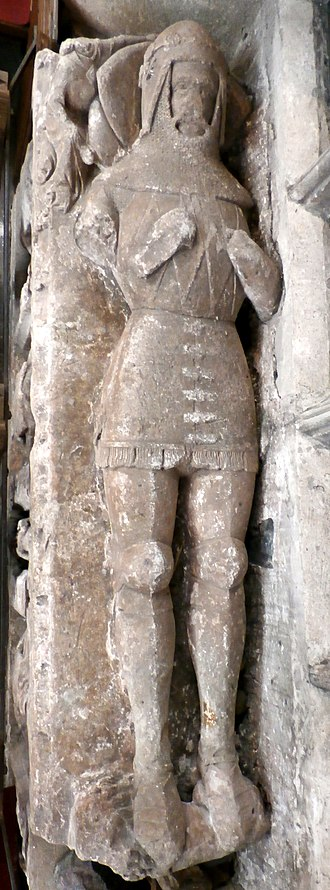 John Dinham (1359–1428) - Effigy of Sir John Dinham (1359-1428), St Mary's Church, Kingskerswell. The arms of Dinham are visible sculpted in low-relief on the chest of his surcoat: four fusils in fess
