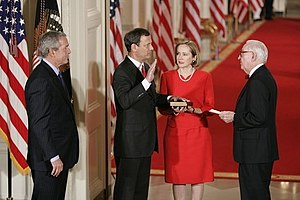 George W. Bush Supreme Court candidates - John Roberts is sworn in as Chief Justice by senior Associate Justice John Paul Stevens in the East Room of the White House on the same day as his confirmation, September 29, 2005.
