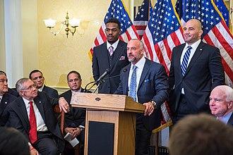 Jon Jones - Jon Jones with Lorenzo Fertitta and Glover Teixeira at a U.S. Senate event in 2014