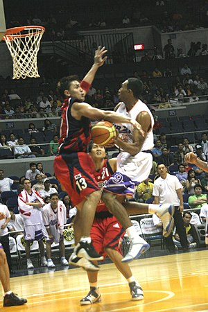 English: Air21's KG Canaleta against Purefoods...